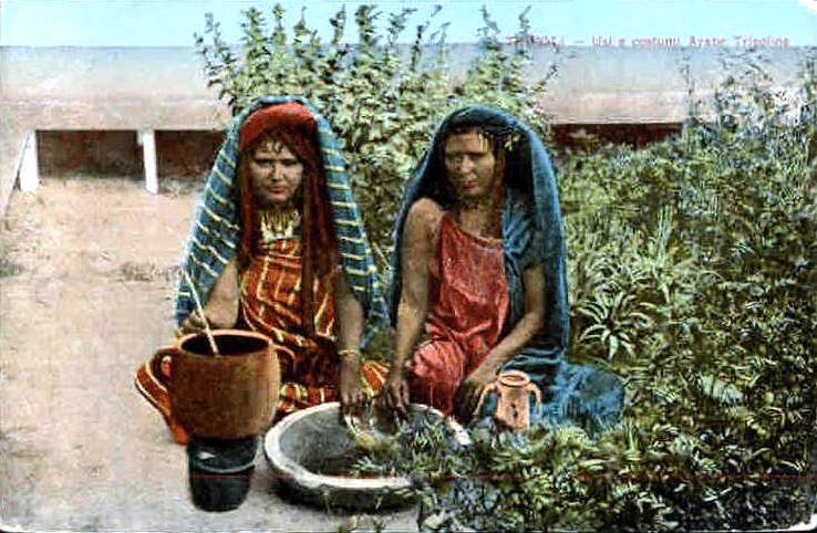 Vintage colorized photo of Libyan girls cooking outdoors using the traditional methods of the indigenous Berbers. (Image date and source unknown)